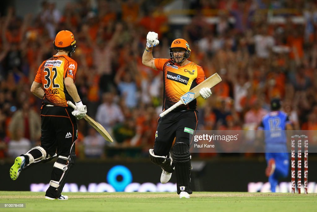Tim Bresnan of the Scorchers celebrates after hitting the winning runs with Adam Voges during the Big Bash League match between the Perth Scorchers and the Adelaide Strikers at WACA on January 25, 2018 in Perth, Australia.