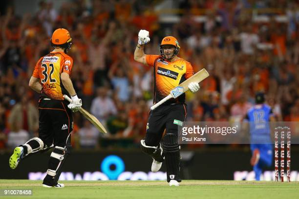 Tim Bresnan of the Scorchers celebrates after hitting the winning runs with Adam Voges during the Big Bash League match between the Perth Scorchers...