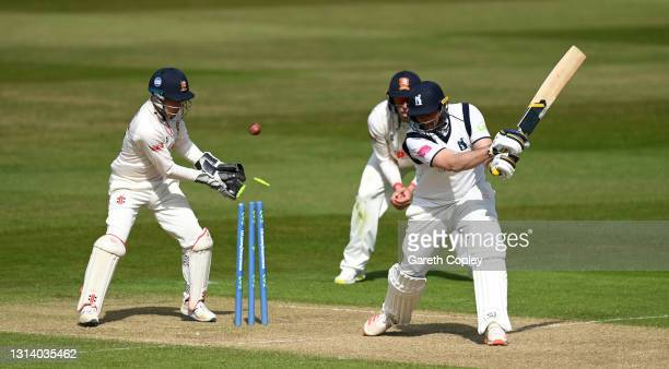 Tim Bresnan of Warwickshire is bowled Simon Harmer of Essex during the LV= Insurance County Championship match between Warwickshire and Essex at...