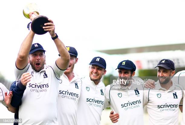 Tim Bresnan of Warwickshire lifts the County Championship Trophy following Day Four of the LV= Insurance County Championship match between...