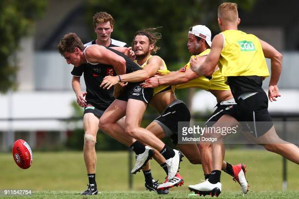 Tim Broomhead lays a tacke during a Collingwood Magpies AFL training session on January 29 2018 in Melbourne Australia