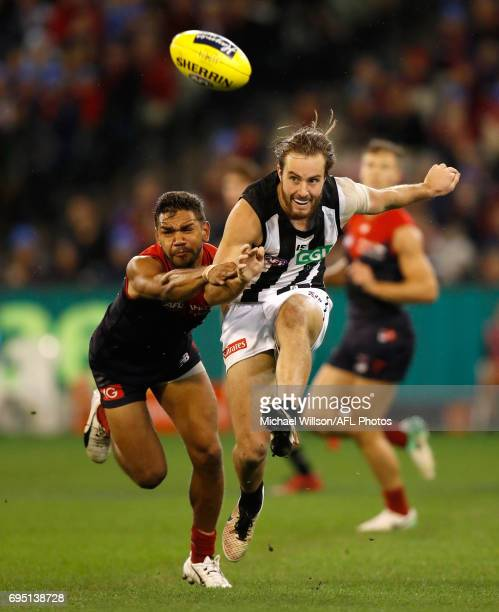 Tim Broomhead of the Magpies and Neville Jetta of the Demons in action during the 2017 AFL round 12 match between the Melbourne Demons and the...