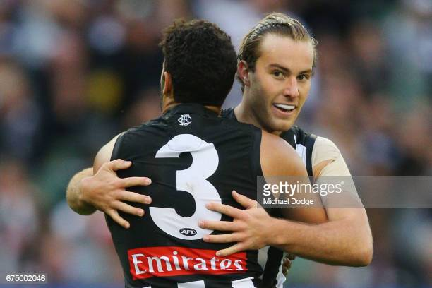 Tim Broomhead of the Magpies celebrates a goal with Daniel Wells during the round six AFL match between the Geelong Cats and the Collingwood Magpies...