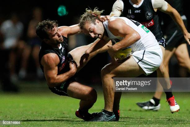 Tim Broomhead of the Magpies is tackled by Jarryd Blair of the Magpies during the Collingwood Magpies AFL Intra Club match at the Holden Centre on...