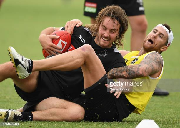 Tim Broomhead of the Magpies is tackled by Jeremy Howe during a Collingwood Magpies AFL training session at Holden Centre on November 27 2017 in...
