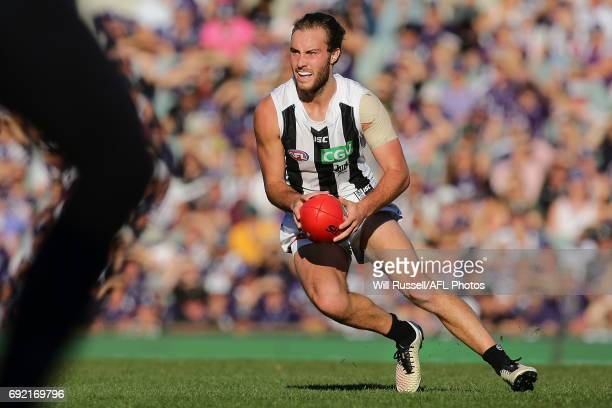 Tim Broomhead of the Magpies looks to pass the ball during the round 11 AFL match between the Fremantle Dockers and the Collingwood Magpies at Domain...