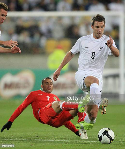 Tim Brown of the All Whites gets tackled by Sayed Mahmood Jala of Bahrain during the 2010 FIFA World Cup Asian Qualifier match between New Zealand...