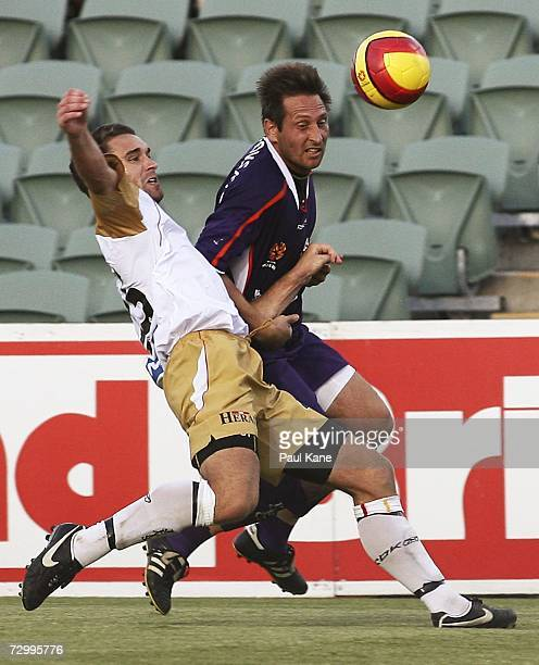 Tim Brown of the Jets and Bobby Despotovski of the Glory contest the ball during the round 20 Hyundai ALeague match between Perth Glory and the...