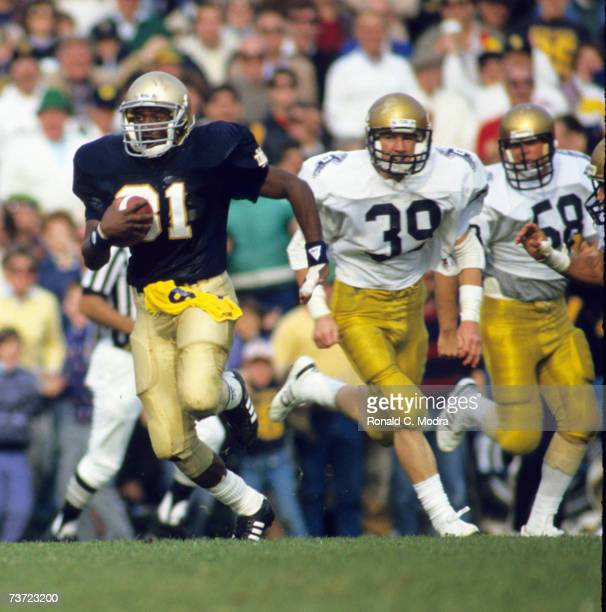 Tim Brown of the Notre Dame Fighting Irish carries the ball during a game against the Navy Midshipmen in November 1987 in South Bend Indiana