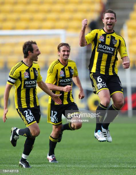 Tim Brown of the Phoenix celebrates his goal while teammates Andrew Durante and Vince Lia look on during the round eight ALeague match between the...