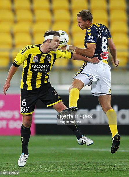 Tim Brown of the Phoenix challenges for a header with Rostyn Griffiths of the Mariners during the round five A-League match between Wellington...