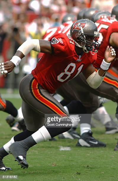 Tim Brown of the Tampa Bay Buccaneers runs against the Washington Redskins on September 12, 2004 at FedEx Field in Landover, Maryland. The Redskins...