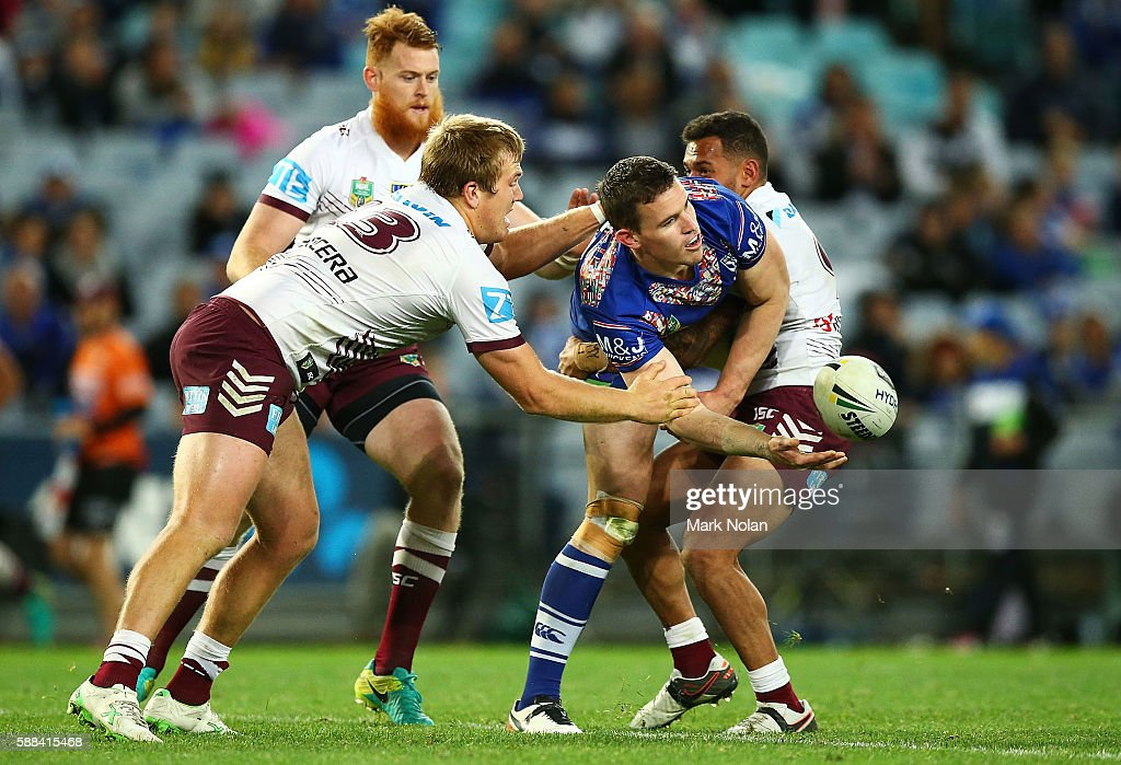 Tim Browne of the Bulldogs offloads during the round 23 NRL match between the Canterbury Bulldogs and the Manly Sea Eagles at ANZ Stadium on August 11, 2016 in Sydney, Australia.