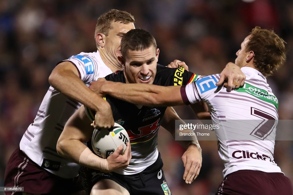 Tim Browne of the Panthers is tackled by the Sea Eagles defence during the round 18 NRL match between the Penrith Panthers and the Manly Sea Eagles at Pepper Stadium on July 8, 2017 in Sydney, Australia.