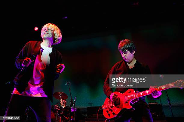 Tim Burgess and Mark Collins of The Charlatans perform live on stage at The Roundhouse on March 16, 2015 in London, England.