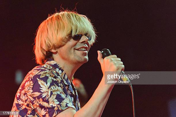 Tim Burgess performs on stage on Day 2 of Reading Festival 2013 at Richfield Avenue on August 24, 2013 in Reading, England.