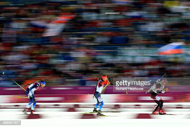 Tim Burke of United States Evgeny Ustyugov of Russia and Christoph Sumann of Austria compete in the Men's 125 km Pursuit during day three of the...