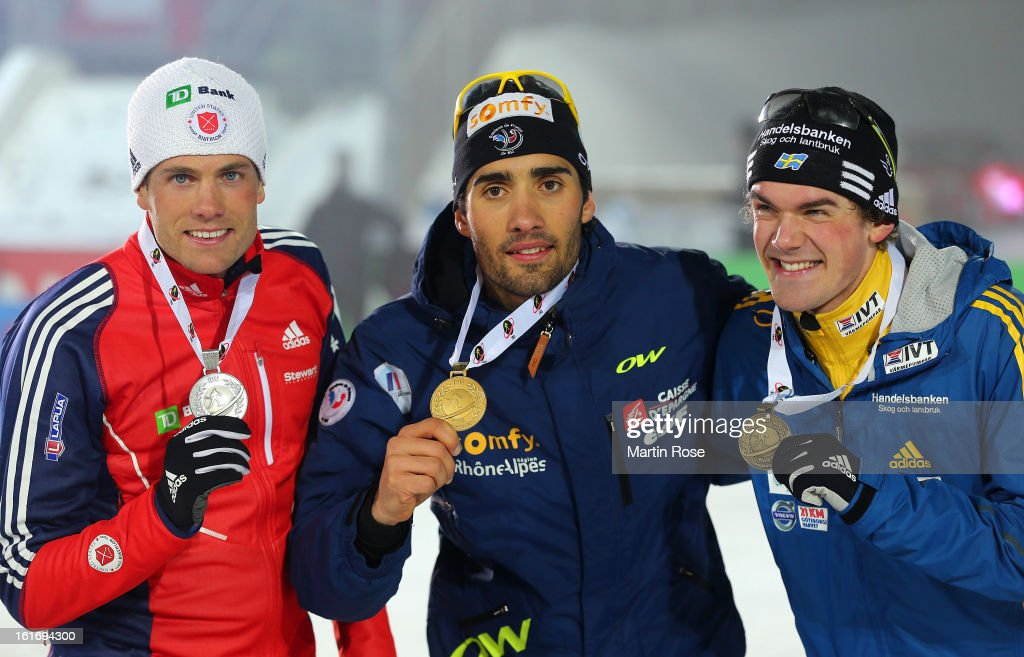 Tim Burke of USA (silver), Martin Fourcade of France (gold) and Frederik Lindstroem of Sweden ( bronze) pose with the medals after the Men's 20km Individual during the IBU Biathlon World Championships at Vysocina Arena on February 14, 2013 in Nove Mesto na Morave, Czech Republic.