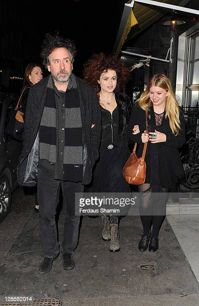 Tim Burton and Helena Bonham Carter with Rose Bonham Carter attend the launch party of Lulu Guinness and Rob Ryan's Fan Bag at Air Gallery on...