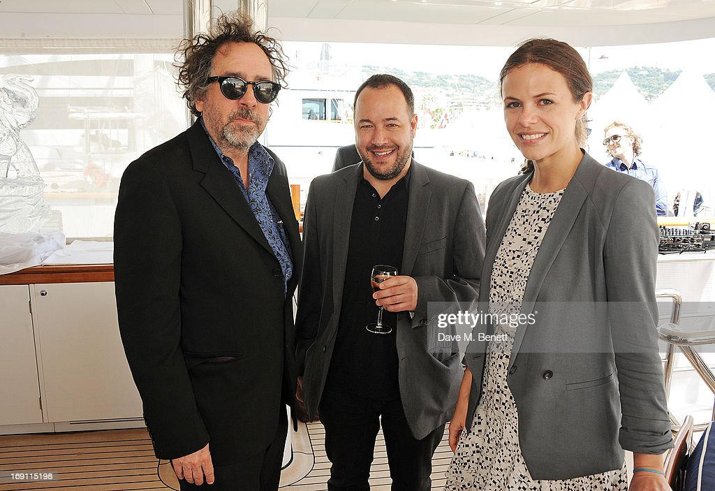 Tim Burton, Derek Frey and Victoria Parker attend a lunch hosted by Len Blavatnik, Harvey Weinstein and Warner Music during the 66th Cannes Film Festival on board the Odessa at Old Port on May 19, 2013 in Cannes, France.