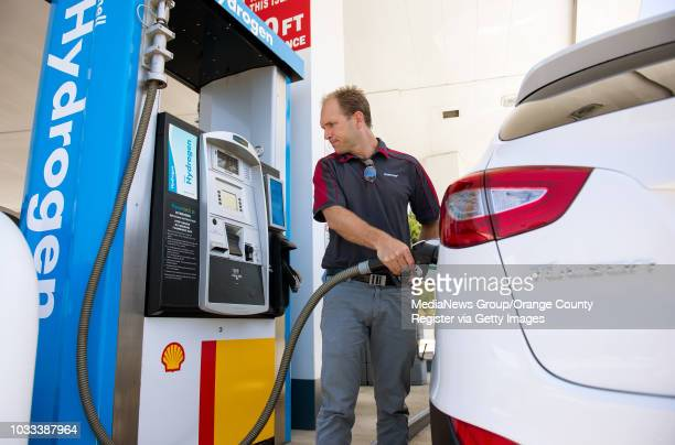 Tim Bush of of Huntington Beach, demonstrates how he fills his Hyundai ix35 Tucson CUV with hydrogen fuel at the Shell station at on Jamboree...