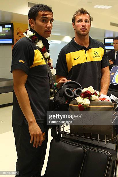 Tim Cahill and Lucas Neill of the Australian Socceroos arrive at the Doha International Airport on January 6 2011 in Doha Qatar