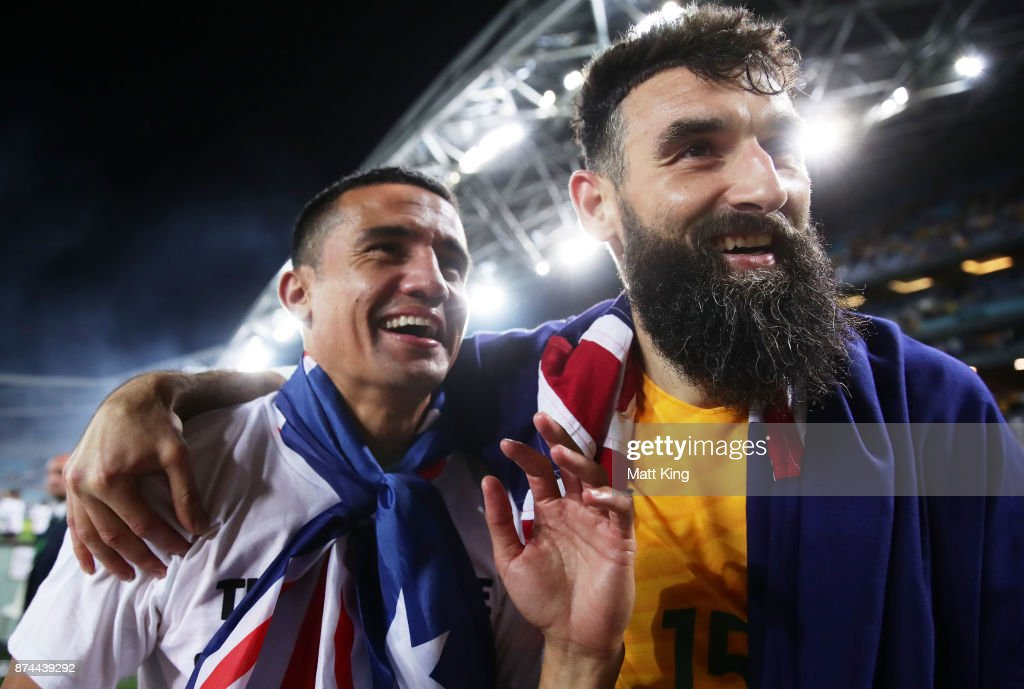 Tim Cahill (L) and Mile Jedinak (R) of Australia celebrate victory after the 2018 FIFA World Cup Qualifiers Leg 2 match between the Australian Socceroos and Honduras at ANZ Stadium on November 15, 2017 in Sydney, Australia.