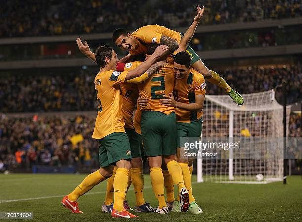 Tim Cahill and the Australians celebrate after Lucas Neill of the Socceroos scored a goal during the FIFA World Cup Qualifier match between the...