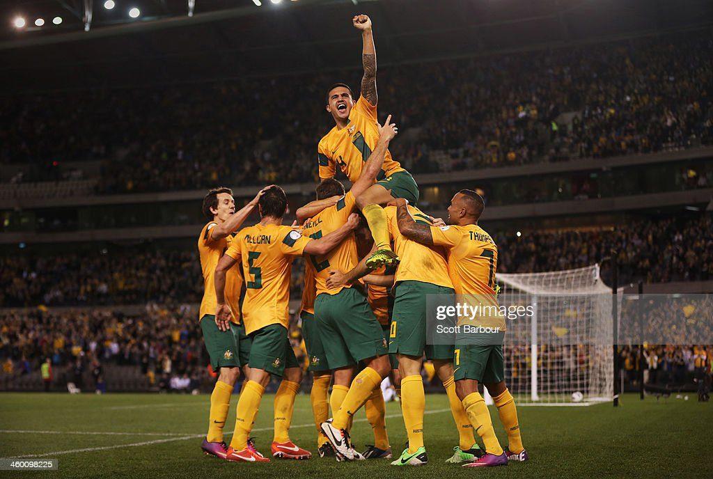 Tim Cahill (top) and the Australians celebrate after Lucas Neill of the Socceroos scored a goal during the FIFA World Cup Qualifier match between the Australian Socceroos and Jordan at Etihad Stadium on June 11, 2013 in Melbourne, Australia.