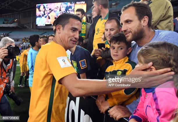 Tim Cahill celebrates with fans after Australia defeated Syria in their 2018 World Cup football qualifying match played in Sydney on October 10 2017...