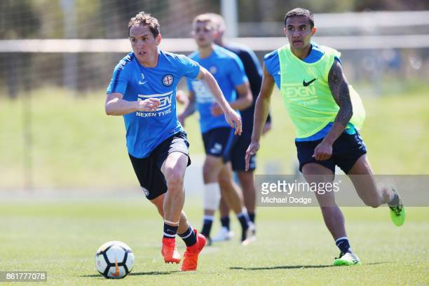 Tim Cahill chases Neil Kilkenny with the ball during a Melbourne City ALeague training session on October 16 2017 in Melbourne Australia