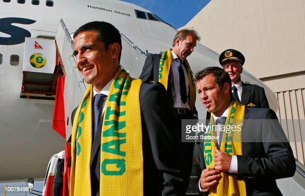 Tim Cahill Coach Pim Verbeek captain Lucas Neill and their pilot prepare to board their aircraft during the Australian Socceroos farewell function at...