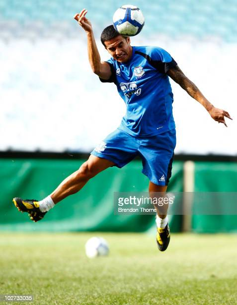 Tim Cahill heads the ball during the Evertone training session at ANZ Stadium on July 9 2010 in Sydney Australia
