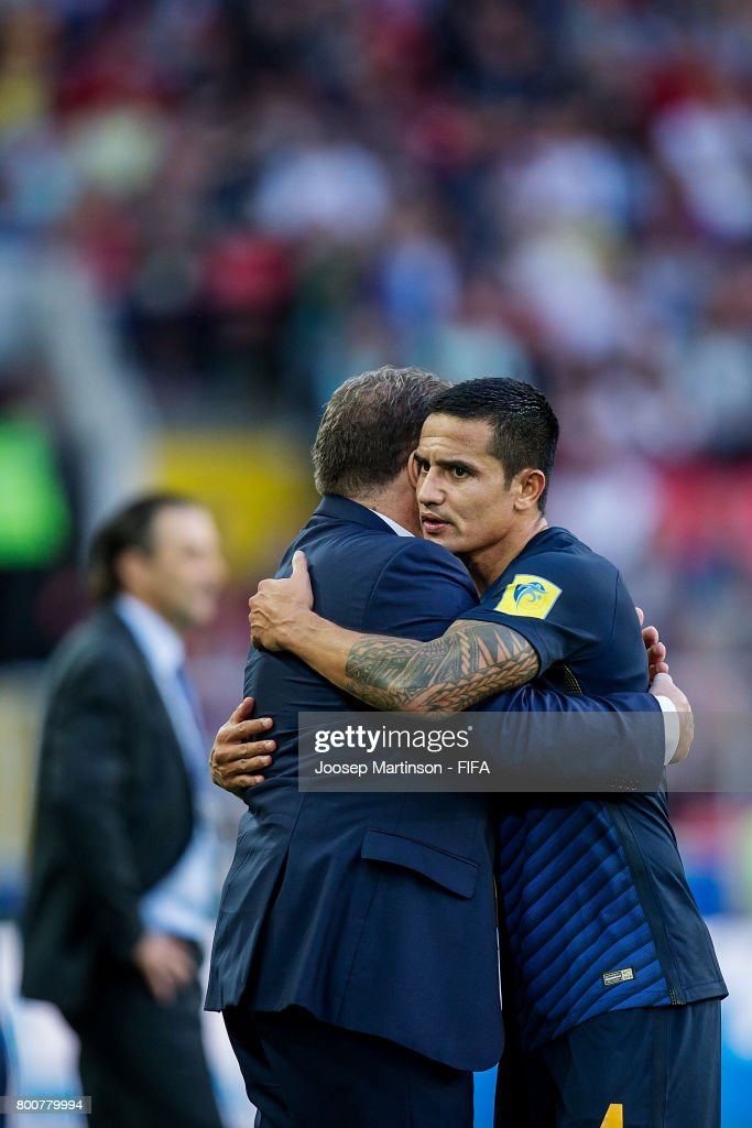 Tim Cahill hugs Ange Postecoglou of Australia after being substituted out in his 100th cap for the Australian national squad during the FIFA Confederations Cup Russia 2017 group B football match between Chile and Australia at Spartak Stadium on June 25, 2017 in Moscow, Russia.
