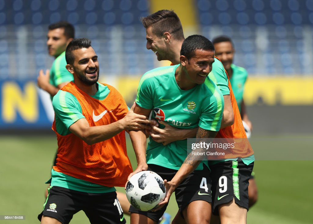Tim Cahill is tackled by Aziz Behich and Tomi Juric of Australia during an Australia Socceroos training session at NV Arena on May 31, 2018 in Sankt Polten, Austria.