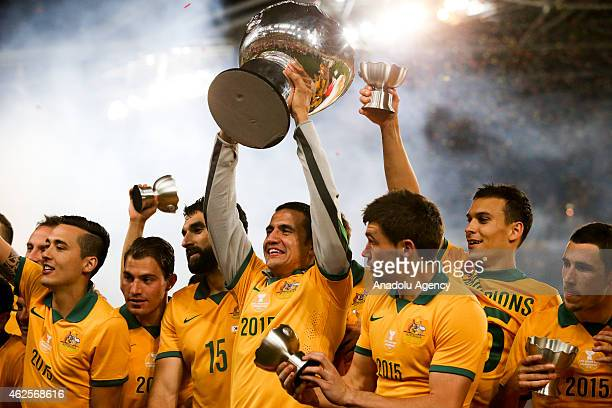 Tim Cahill lifts the trophy during the 2015 Asia Cup Final between Australia Vs South Korea in the 2015 AFC Asian Cup match played at the Stadium...