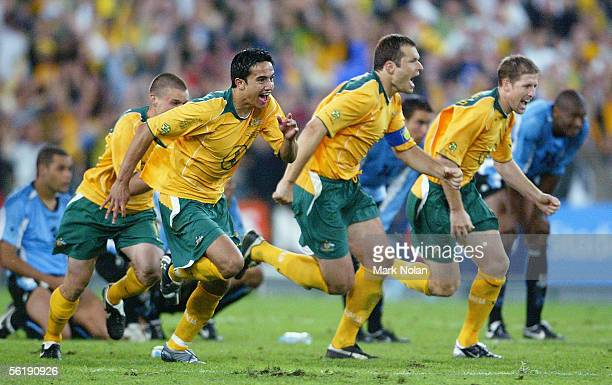 Tim Cahill, Mark Viduka and Scott Chipperfield of the Socceroos celebrate winning the second leg of the 2006 FIFA World Cup qualifying match between...