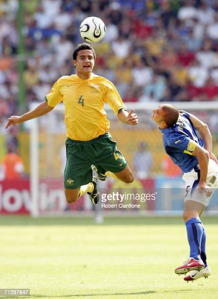Tim Cahill of Austalia heads the ball as Fabio Cannavaro of Italy closes in during the FIFA World Cup Germany 2006 Round of 16 match between Italy...