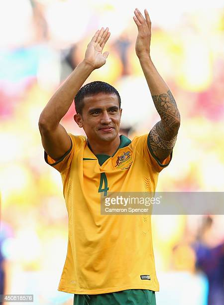 Tim Cahill of Australia acknowledges the fans after being defeated by the Netherlands 3-2 during the 2014 FIFA World Cup Brazil Group B match between...
