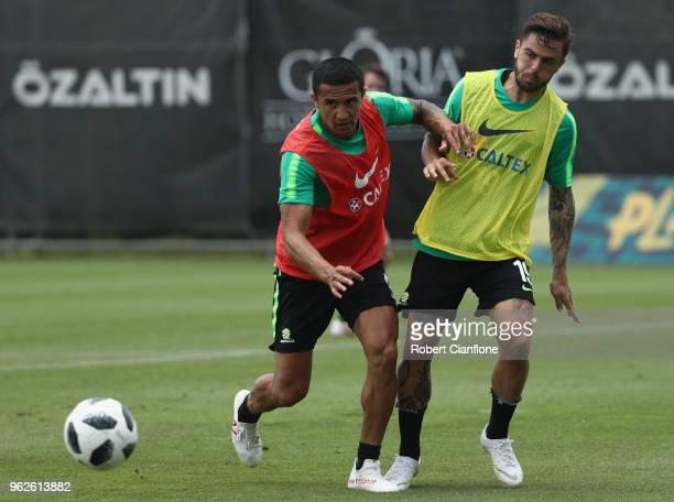 Tim Cahill of Australia and Josh Risdon compete for the ball during the Australian Socceroos Training Session at the Gloria Football Club on May 26...