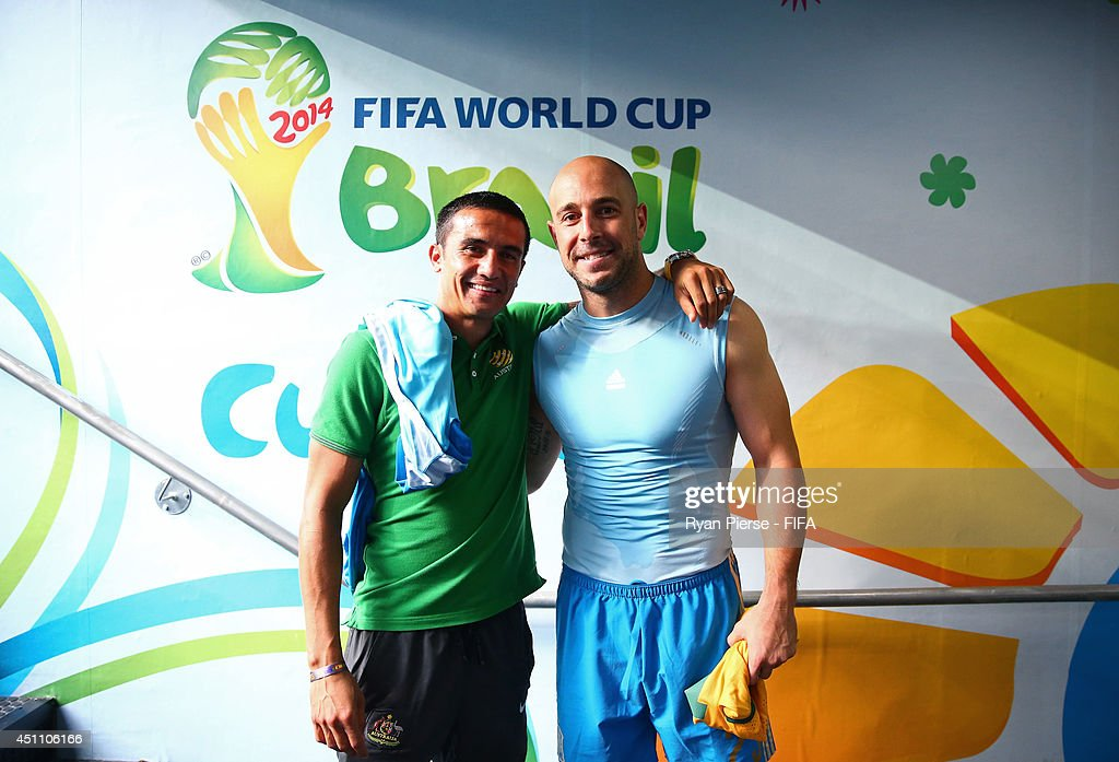 Tim Cahill of Australia and Pepe Reina of Spain pose for photographs after the 2014 FIFA World Cup Brazil Group B match between Australia and Spain at Arena da Baixada on June 23, 2014 in Curitiba, Brazil.
