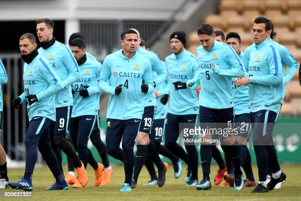 Tim Cahill of Australia and the Australian Socceroos teams warmup during a training session at Arasen Stadion on March 21 2018 in Oslo Norway