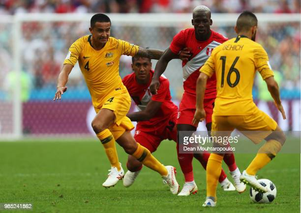 Tim Cahill of Australia battles for the ball with Aldo Corzo and Luis Advincula of Peru during the 2018 FIFA World Cup Russia group C match between...
