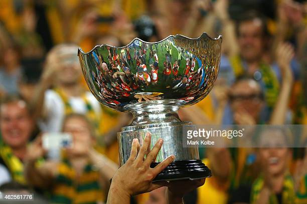 Tim Cahill of Australia carries the trophy aloft on the lap of honour during the 2015 Asian Cup final match between Korea Republic and the Australian...