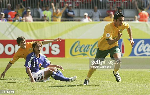 Tim Cahill of Australia celebrates after scoring his team's first goal during the FIFA World Cup Germany 2006 Group F match between Australia and...
