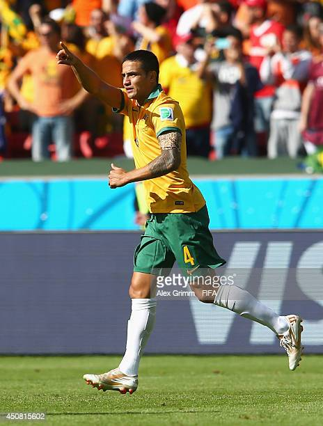 Tim Cahill of Australia celebrates after scoring the team's first goal during the 2014 FIFA World Cup Brazil Group B match between Australia and...