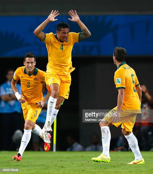 Tim Cahill of Australia celebrates scoring his team's first goal with Jason Davidson and Mark Milligan during the 2014 FIFA World Cup Brazil Group B...