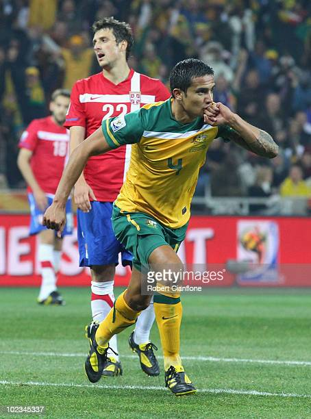 Tim Cahill of Australia celebrates scoring the opening goal during the 2010 FIFA World Cup South Africa Group D match between Australia and Serbia at...