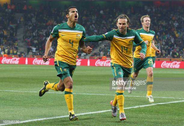 Tim Cahill of Australia celebrates scoring the opening goal with team mates Brett Holman and David Carney during the 2010 FIFA World Cup South Africa...
