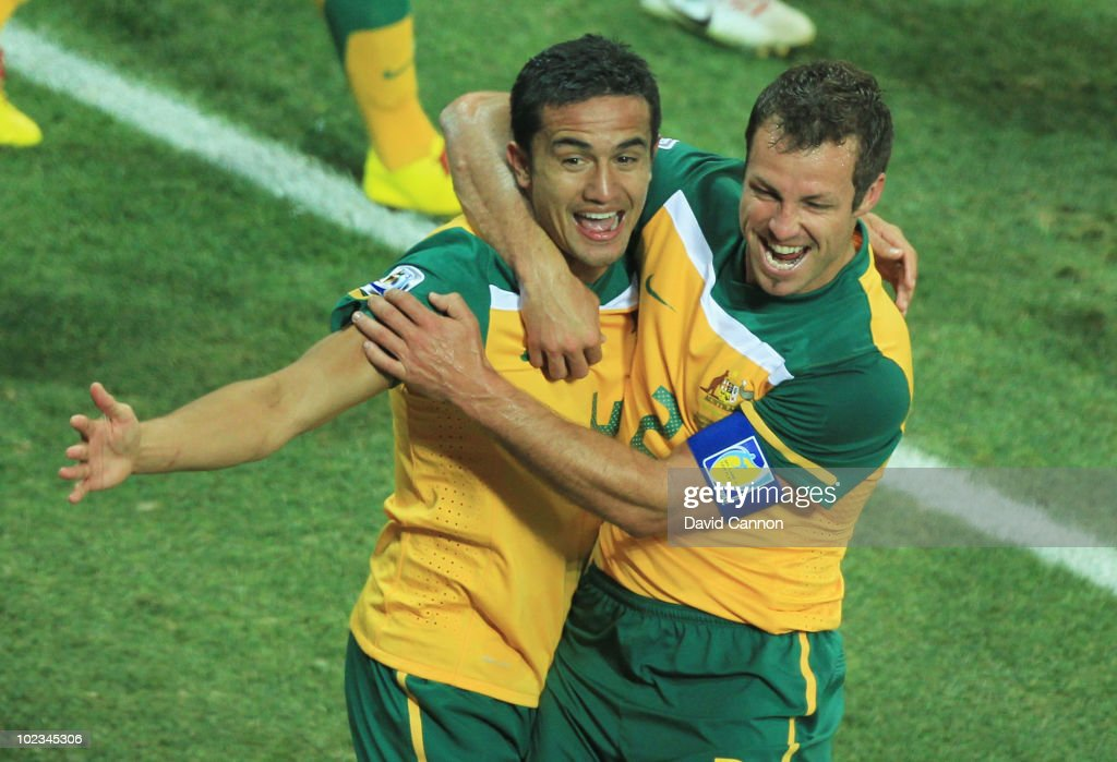 Tim Cahill of Australia celebrates scoring the opening goal with team mate Lucas Neill during the 2010 FIFA World Cup South Africa Group D match between Australia and Serbia at Mbombela Stadium on June 23, 2010 in Nelspruit, South Africa.